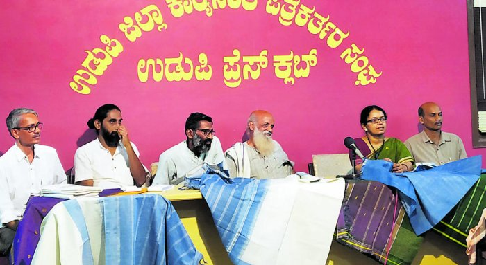 Charaka organistaion's Prasanna Heggodu (second from right) speaks to mediapersons in Udupi on Monday.