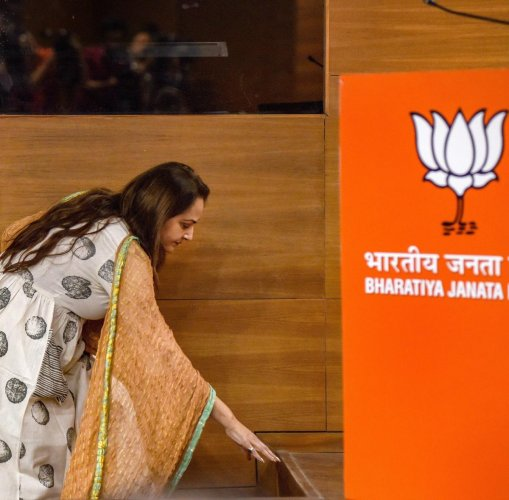 Veteran actor and former MP Jaya Prada touches the floor before stepping on the dais as she arrives to join the BJP in New Delhi on Tuesday. PTI