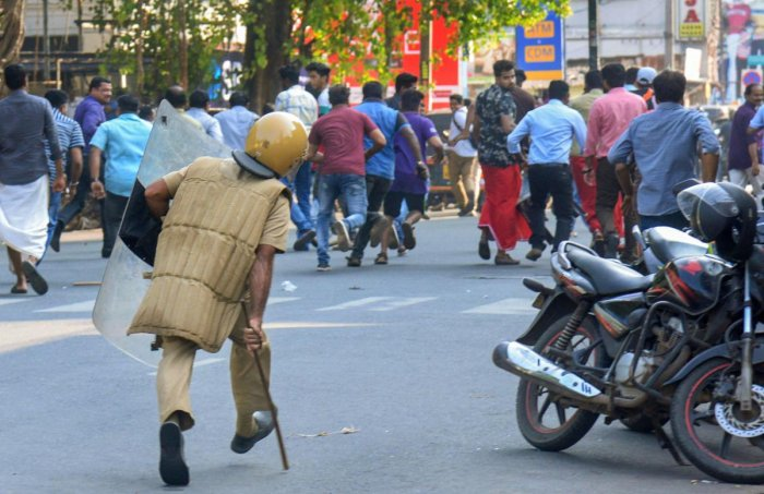 Protestors turned violent at many places and attacked shops and buses. Kerala State RTC stopped services as around 50 buses were damaged by the protestors. (PTI)