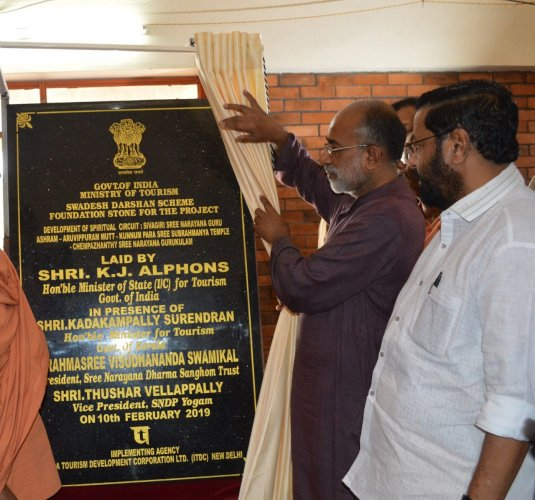 Union Minister of State for Tourism Alphons Kannanthanam releasing the plaque during the inauguration of the Sivagiri Pilgrim Circuit project work under the Swadesh Darshan Scheme at Sivagiri Mutt in Thiruvananthapuram on Sunday. Kerala Tourism Minister Kadakampally Surendran is also seen - Picture from PIB