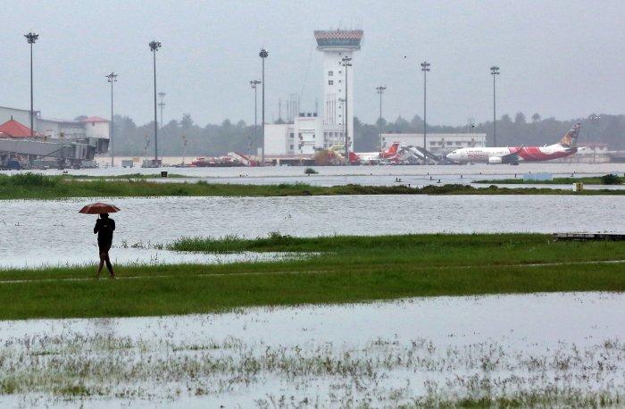 A man walks inside the flooded Cochin international airport after the opening of Idamalayar, Cheruthoni and Mullaperiyar dam shutters following heavy rain, on the outskirts of Kochi. Reuters