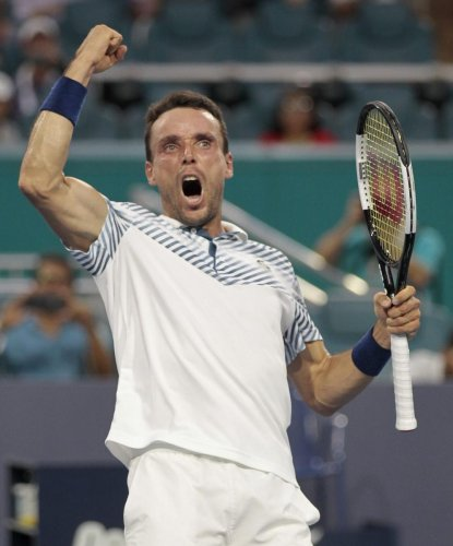 Pumped up: Roberto Bautista Agut celebrates his win over Novak Djokovic during the Miami Open on Tuesday. AFP