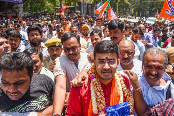 Bangalore South BJP candidate Tejasvi Surya L S takes out a rally near Dodda Ganapathi Temple in Basavanagudi before filing his nomination in Bengaluru. DH photo/S K Dinesh