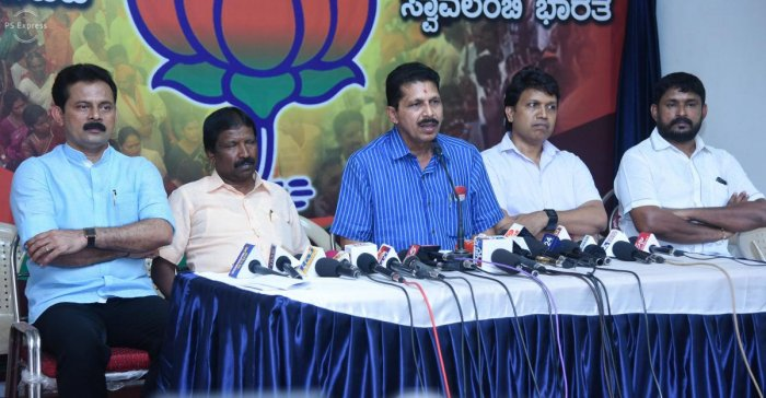 BJP district unit president and Puttur MLA Sanjeev Matandoor (centre) speaks to reporters on Tuesday.