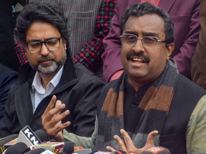 Bhartiya Janta Party (BJP) National General Secretary Ram Madhav speaks, as the party candidate for Srinagar parliamentary constituency Khalid Jehangir looks on, during a press conference, in Srinagar, Wednesday, March 27, 2019. (PTI Photo)
