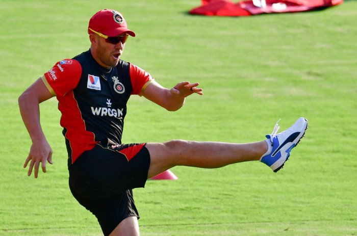 gearing up AB de Villiers at a training session on the eve of Royal Challengers Bangalore's game against Mumbai Indians. Dh photo/ krishna Kumar P S