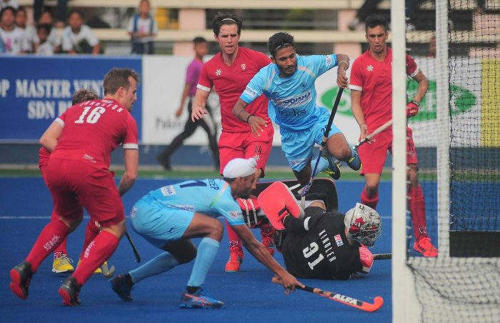 On target India's Mandeep Singh (left) scores against Canada in the Azlan Shah hockey tournament in Ipoh. HI Media