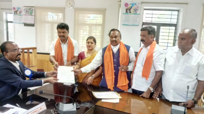 BJP nominee B Y Raghavendra files nomination papers to the district election officer K A Dayananda in Shivamogga on Thursday.