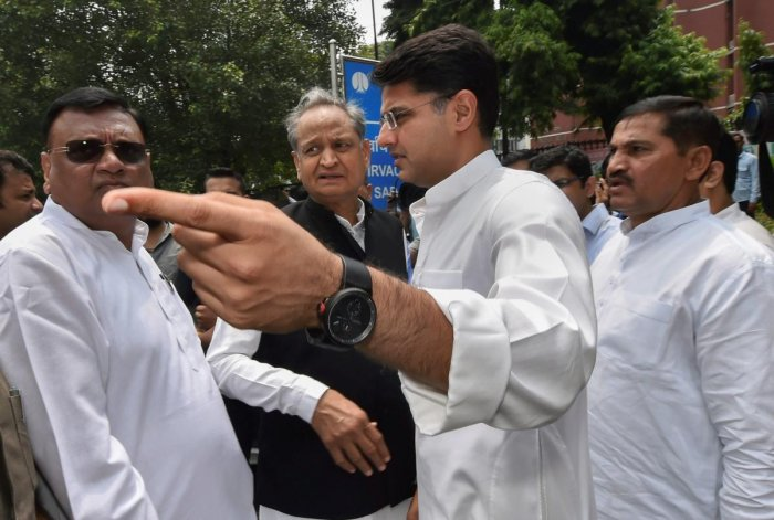 Congress leaders Ashok Gehlot and Sachin Pilot leave after a meeting with the Election Commissioner at Nirvachan Sadan, in New Delhi on Tuesday. PTI