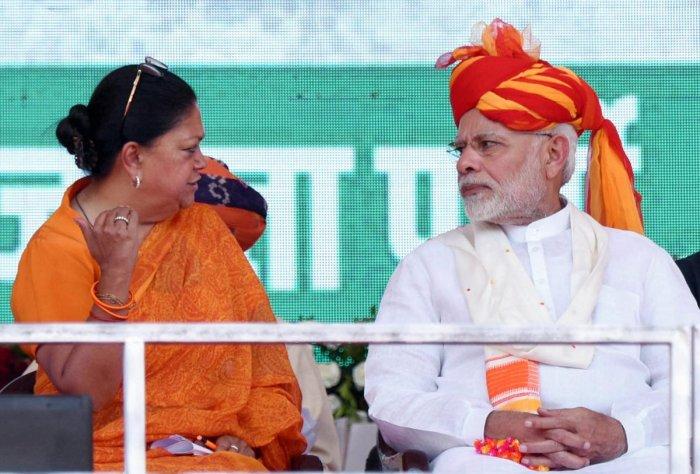 Prime Minister Narendra Modi and Rajasthan Chief Minister Vasundhara Raje during 'Vijay Sankalp Sabha', in Ajmer, Saturday, Oct 6, 2018. (PTI Photo)