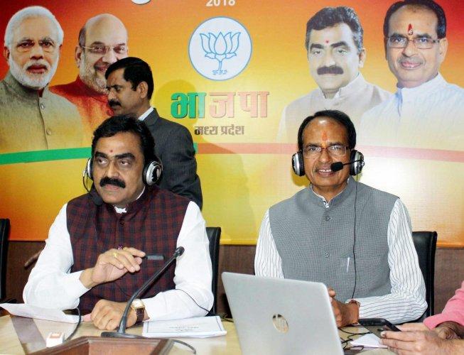 Madhya Pradesh Chief Minister Shivraj Singh Chouhan and BJP State President Rakesh Singh. PTI Photo