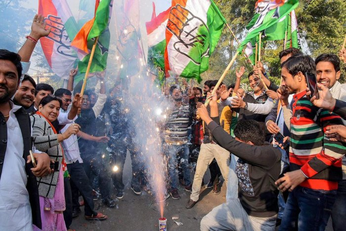Congress workers and supporters burst fire crackers to celebrate the counting trends that show the party's win in the Rajasthan Assembly elections, in Jaipur, Tuesday, Dec 11, 2018. (PTI Photo)