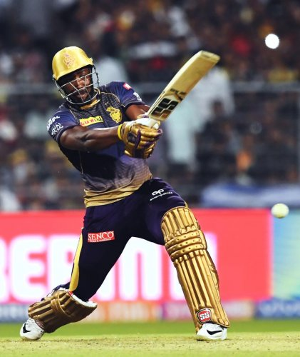 Andre Russell en route to his 48.