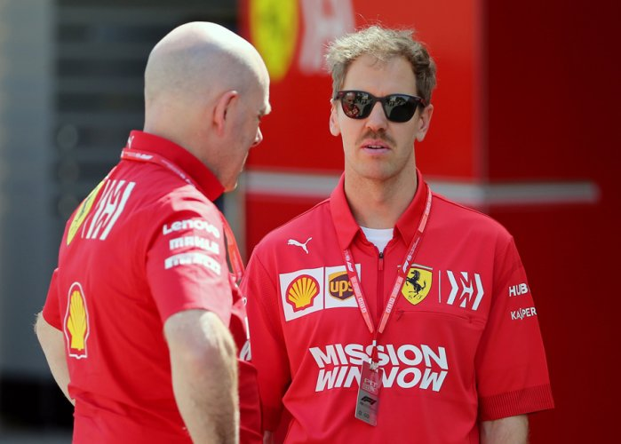 Ferrari's Sebastian Vettel in conversation with team personnel ahead of the Bahrain Grand Prix this Sunday. Picture credit: Reuters
