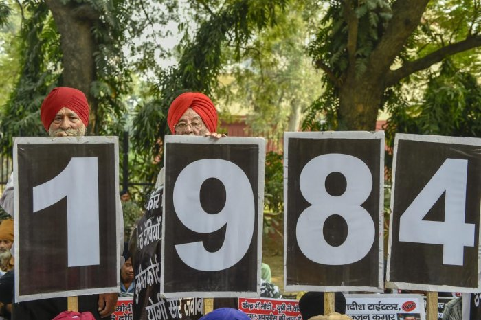New Delhi: Family members of the victims of 1984 anti-Sikh riots stage a protest at Jantar Mantar, in New Delhi, Thursday, Nov 1, 2018. (PTI Photo/Ravi Choudhary) (PTI11_1_2018_000104B)