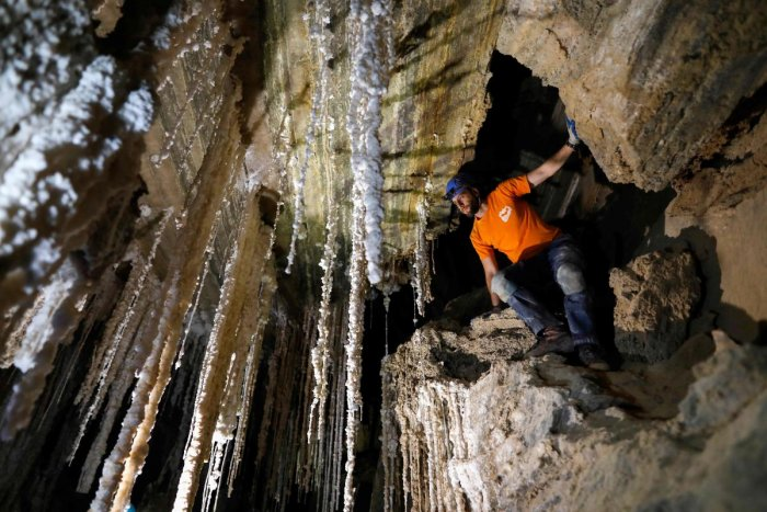 Efraim Cohen of the Israel Cave Explorers Club, and of the Malham Cave Mapping Expedition, shows journalists salt stalactites in the Malham cave inside Mount Sodom, located at the southern part of the Dead Sea in Israel. AFP