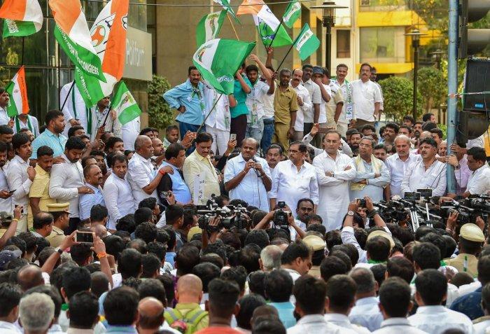 Chief Minister H D Kumaraswamy, his deputy G Parameshwara, KPCC president Dinesh Gundu Rao, former chief minister Siddaramaiah and minister D K Shivakumar during a protest against the income tax raids on JD(S) leaders in Bengaluru Thursday. PTI