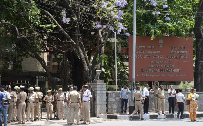 Security was beefed up at the office of the Department of Income Tax in Bengaluru, following protests by the Congress and the JD(S) leaders against I-T raids on JD(S) leaders, on Thursday. DH Photo