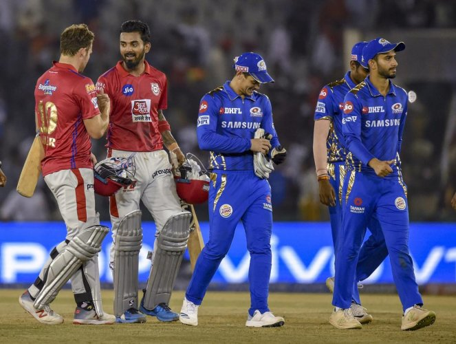 Kings XI Punjab KXIP player KL Rahul celebrates with his teammate after winning the Indian Premier League 2019 (IPL T20) cricket match against Mumbai Indians (MI) at IS Bindra Cricket Stadium in Mohali, Saturday. PTI photo