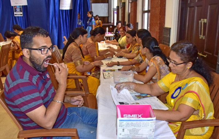 People take part in a stem cell donors' registration drive held at Bhuvanendra Hall, Canara High School, Dongarakeri, on Saturday.