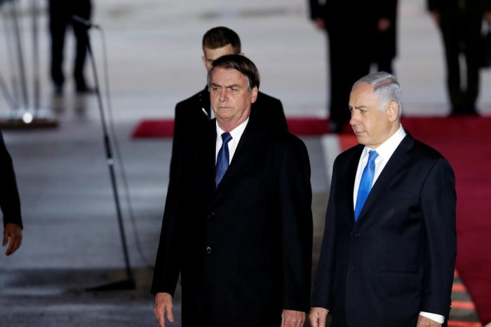 Brazilian President Jair Bolsonaro stands next to Israeli Prime Minister Benjamin Netanyahu during a welcoming ceremony upon his arrival in Israel, at Ben Gurion International airport in Lod, near Tel Aviv, Israel March 31, 2019. REUTERS