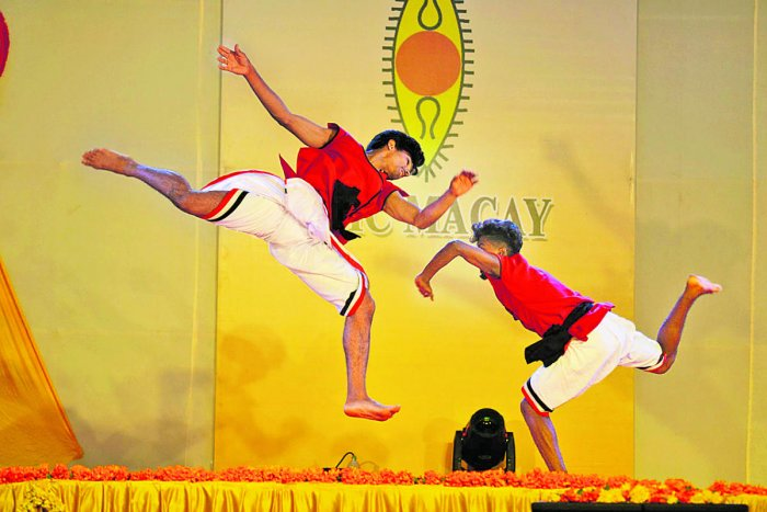 Students of Vallabhat centre of Kerala perform 'Kalaripayattu' martial art form at Bharatiya Vidya Bhavana Kodagu Vidyalaya in Madikeri on Saturday evening.