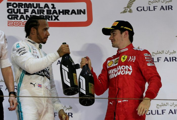 CHEERS: Mercedes' Lewis Hamilton celebrates his victory with Ferrari's Charles Leclerc on the podium after the Bahrain Grand Prix on Sunday. Reuters