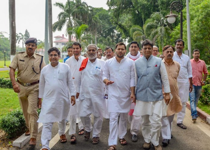 Opposition leader in Bihar Tejashwi Yadav with RJD and Congress MLAs after meeting with Bihar Governor Satyapal Malik to stake claim to form the government in the state, being the single largest party in the Legislative Assembly, in Patna on Friday. PTI