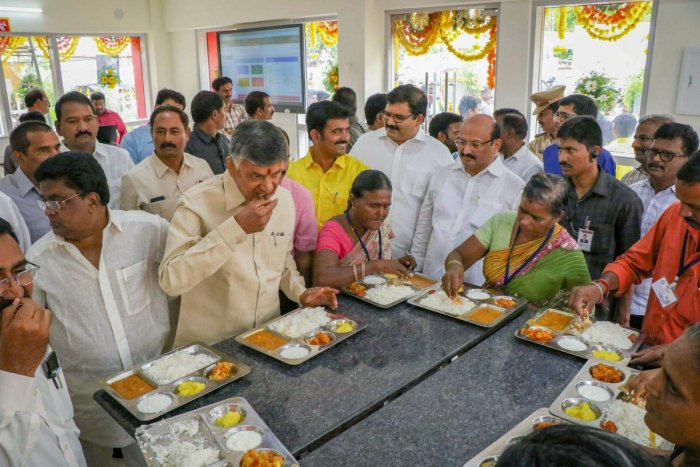 Andhra Pradesh Chief Minister N Chandrababu Naidu has lunch during the launch of Phase I of 'Anna Canteens', that serves meals for Rs. 5, in Vijayawada on Wednesday. PTI Photo