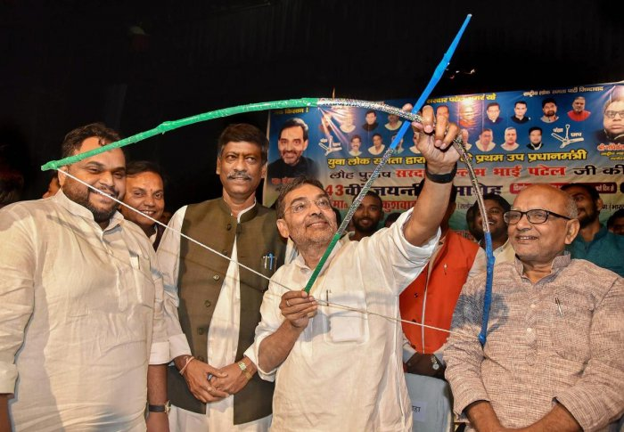 Union minister and RLSP president Upendra Kushwaha holds a bow and arrow during the celebration of the 143rd birth anniversary of Sardar Vallabhbhai Patel at Rabindra Bhawan in Patna. PTI