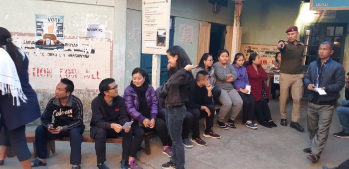People wait to caste their vote at a polling booth in Mizoram.