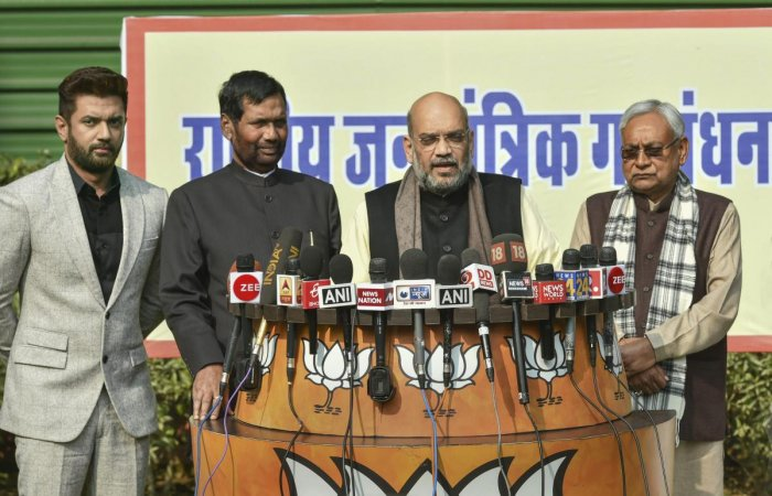 Shah made the announcement in the presence of JD (U) president and Bihar Chief Minister Nitish Kumar and Lok Janshakti Party chief and Union minister Ram Vilas Paswan. (PTI Photo)