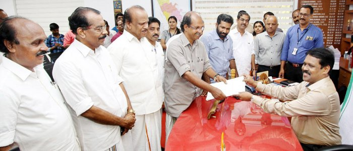 Left Democratic Front (LDF) candidate K P Sathish Chandran submits his nomination papers in Kasargod on Saturday.