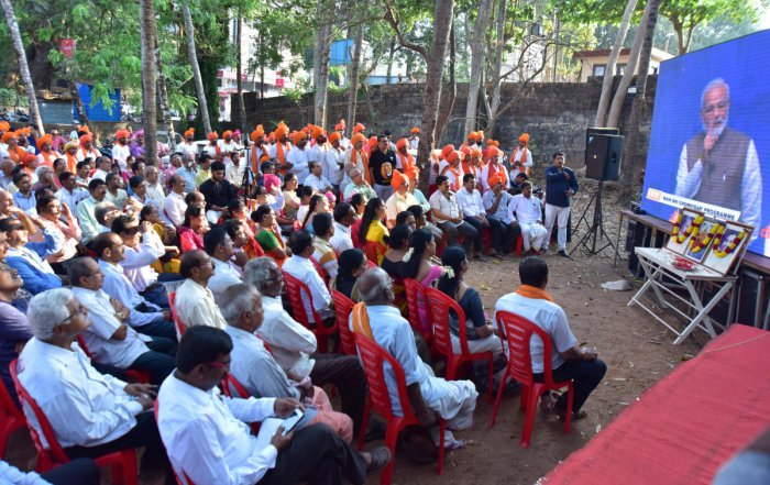 People at the inauguration of screening of 'Main Bhi Chowkidar' live address by Prime Minister Narendra Modi, at BJP district election office in Mangaluru on Sunday.