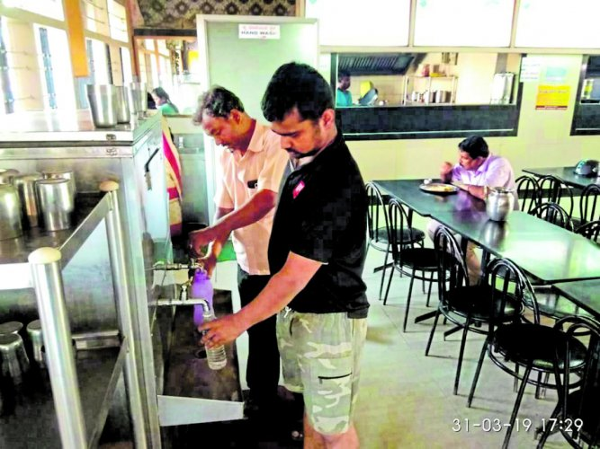 Passengers at KSRTC bus stand fill their water bottles from the taps available in hotels.