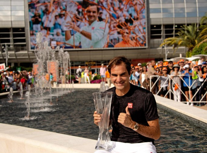 CLASSY: Roger Federer of Switzerland poses with the Miami Open trophy after defeating John Isner of the United States. USA Today