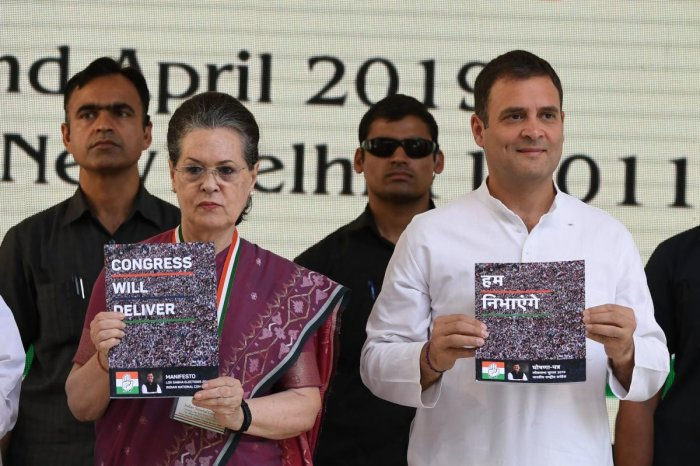 Indian National Congress party president Rahul Gandhi (R) and the party's former president Sonia Gandhi (L) pose with copies of their party election manifesto in New Delhi on April 2, 2019. (AFP)