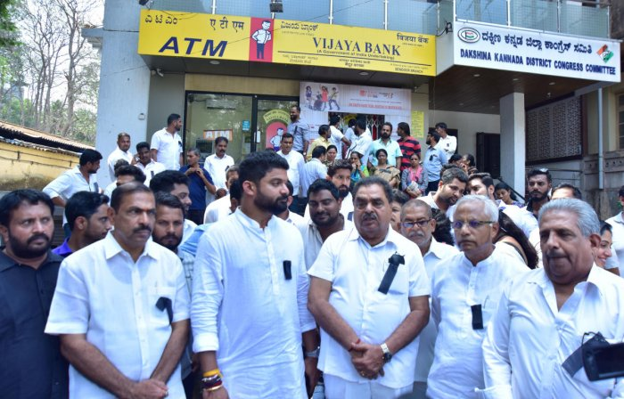 Congress leaders stage a protest in front of Vijaya Bank Mallikatte branch on Monday.