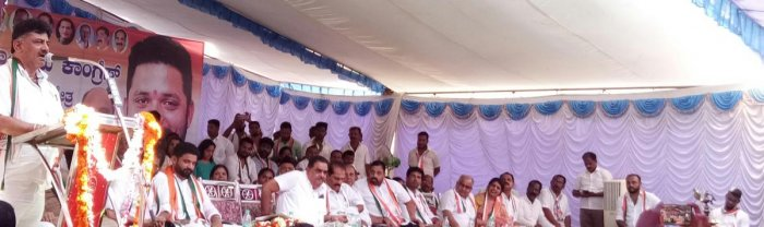 Water Resources Minister D K Shivakumar speaks during an election campaign at Belthangady on Monday. Candidate Mithun Rai, former ministers Ramanath Rai and Gangadhar Gowda, former MLA Vasanth Bangera, District In-charge Minister U T Khader and others loo