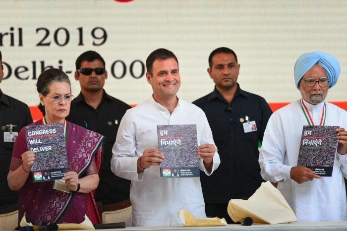 Congress President Rahul Gandhi, senior party leaders Sonia Gandhi and Manmohan Singh release party's manifesto for Lok Sabha polls 2019, in New Delhi on Tuesday. (PTI Photo)