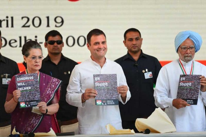 Congress President Rahul Gandhi, senior party leaders Sonia Gandhi and Manmohan Singh release the party's manifesto for Lok Sabha polls 2019, in New Delhi. (PTI Photo)