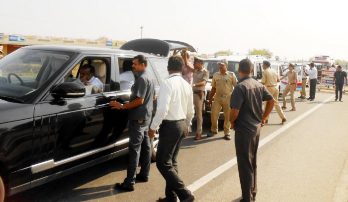 Officials on poll duty intercept Chief Minister H D Kumaraswamy's car, on National Highway 75, at Hirisave, Hassan district, on Wednesday.