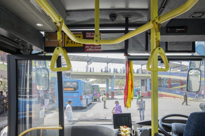 Three womendiverted the attention of a lawyer and his wife, and stole three gold chains on a BMTC bus on March 30, police said.