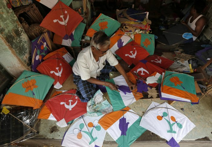 A kite-maker prepares kites with election symbols of political parties at his shop ahead of the general election, in Kolkata. REUTERS