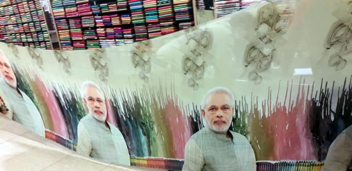 A saree with the pictures of Prime Minister Narendra Modi at a textile showroom in Udyavara in Udupi district.