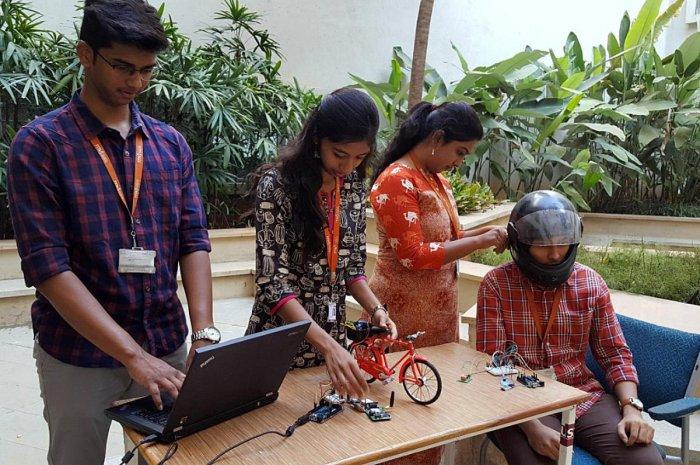 Students of MVJ College of Engineering demonstrate the smart helmet.