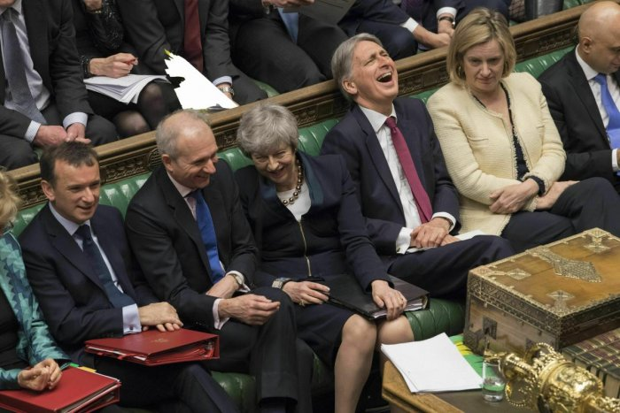 In this photo provided by the UK Parliament, Britain's Prime Minister Theresa May, center, laughs during Prime Minister's question in the Palace of Westminster in London. (AP/PTI Photo)