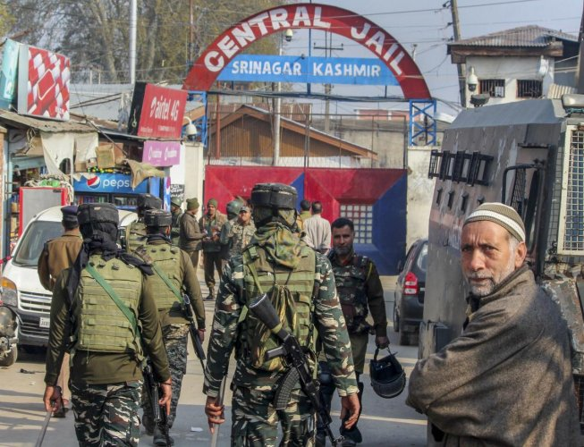Family members of the inmates wait outside the Central Jail Srinagar after clashes between prisoners and the staff of the Jail, in Srinagar, Friday, April 05, 2019. According to the officials, prisoners went on a rampage against the move to shift them within the prison facility for a renovation of some barracks. (PTI Photo)