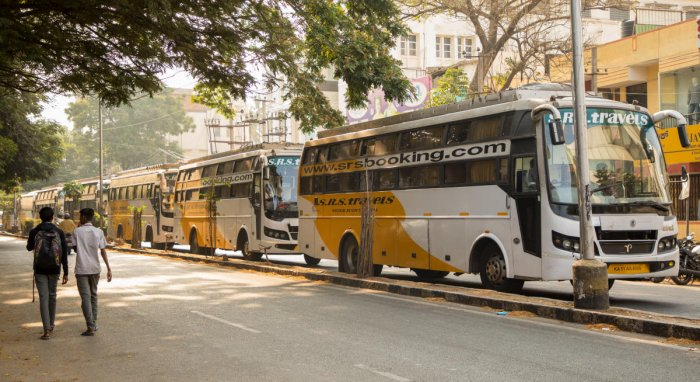 Buses belonging to SRS Travels are parked wrongly on the main road for three to four hours, narrowing the space available for other vehicles to get by. DH Photos by Sudheesha K G and prarthan d r