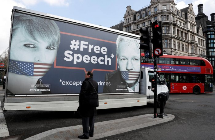 A truck carrying a poster relating to WikiLeaks founder Julian Assange, who has been living at Ecuador's embassy in London, drives through London, Britain April 3, 2019. REUTERS